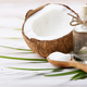 Coconut shell pieces and palm leaves on white wooden table - PhotoDune Item for Sale