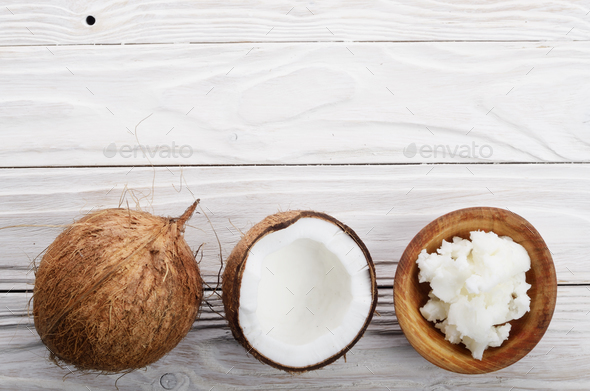 Flat lay background of coconut, coconut shell, hard oil in woode - Stock Photo - Images