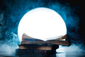 An open book of spells in full Moon. Reader imagination and writing inspiration concept with copy - PhotoDune Item for Sale