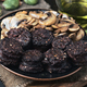 sliced mushrooms and blood sausage, fried in a porcelain dish on wood - PhotoDune Item for Sale