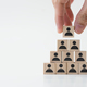 Businessman stacking wooden team blocks - PhotoDune Item for Sale
