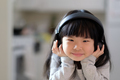 A young asian girl enjoying listening to music on her headphone - PhotoDune Item for Sale