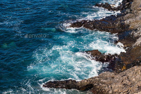 beautiful view on blue ocean water and rocky coast line - Stock Photo - Images