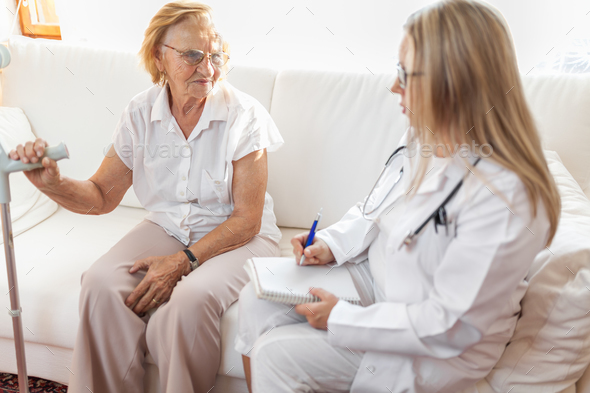 Senior woman during a medical exam with practitioner - Stock Photo - Images