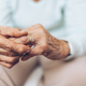 Heartbroken elderly woman holding a wedding ring - PhotoDune Item for Sale