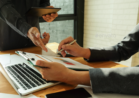 Business team analyzes the data from the graphs. - Stock Photo - Images
