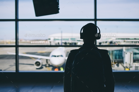 Traveler with headphones - Stock Photo - Images