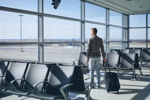 Traveler in airport terminal - Stock Photo - Images