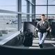Traveler using laptop in airport terminal - PhotoDune Item for Sale