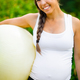 Smiling Young Expectant Mother Holding Fitness Ball In Park - PhotoDune Item for Sale