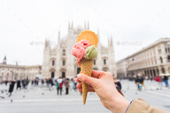 Travel, Italy, gelato and holidays concept - Ice cream in front of Milan Cathedral Duomo - Stock Photo - Images