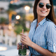 Beautiful young happy woman smiling and drinking cocktail - PhotoDune Item for Sale