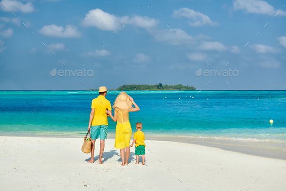 Family with three year old boy on beach - Stock Photo - Images