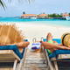 Couple at beach on wooden sun bed loungers - PhotoDune Item for Sale