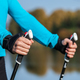 Closeup of woman's hand with nordic walking poles - PhotoDune Item for Sale