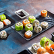 Traditional Japanese food- sushi, rolls, chopsticks, soy sauce on color stone background. Sushi menu - PhotoDune Item for Sale