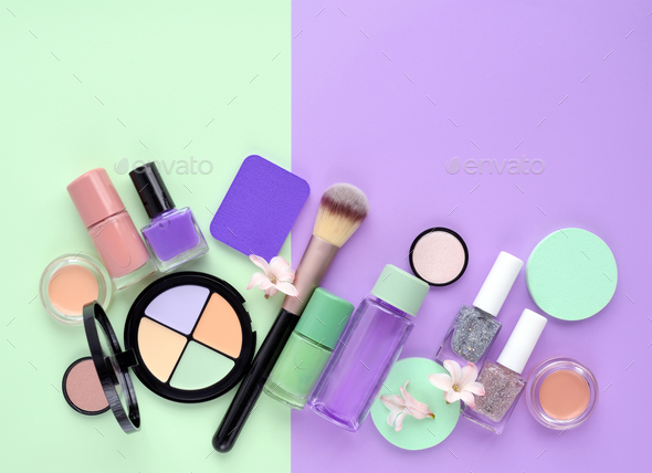 Decorative cosmetics and nail polishes on color background, with - Stock Photo - Images