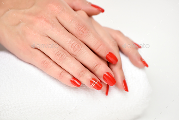 Manicure - Beautiful manicured woman's nails with red nail polis - Stock Photo - Images