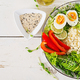 Couscous, egg and vegetables bowl. Healthy, diet, vegetarian food concept. - PhotoDune Item for Sale