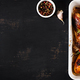 Appetizing oven baked golden chicken drumsticks  in a baking dish on a dark table. Asian cuisine. - PhotoDune Item for Sale