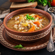 Barley soup with carrots, tomato, celery and meat on a dark background. - PhotoDune Item for Sale
