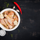 Raw uncooked marinated chicken legs, drumsticks for cooking on dark table. Asian cuisine. Top view - PhotoDune Item for Sale