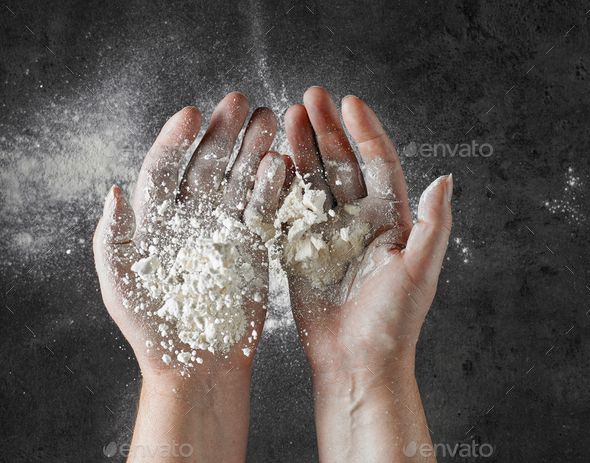 baker hands with flour in motion - Stock Photo - Images