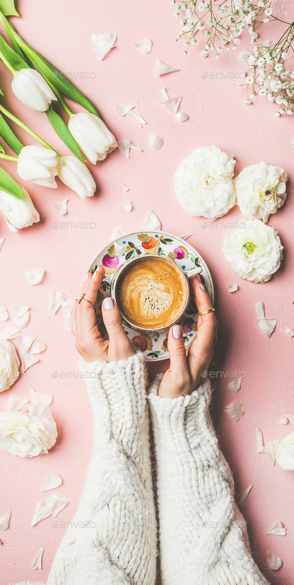 Spring layout with Coffee in female hands and white flowers - Stock Photo - Images