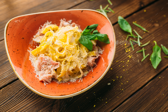 Pasta and meat in a bowl on wooden table, nobody - Stock Photo - Images
