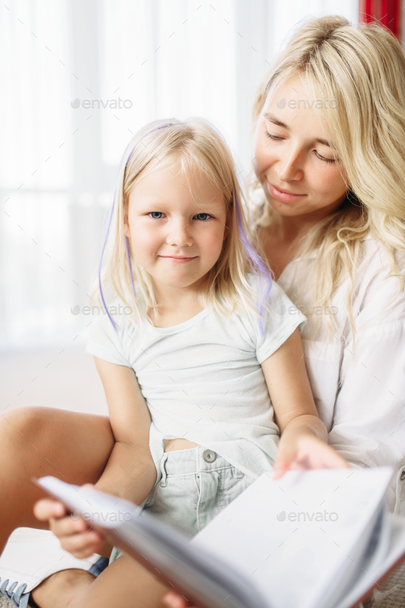 Mother and child have fun together at home - Stock Photo - Images