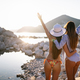Group of beautiful young women friends walking on the beach - PhotoDune Item for Sale
