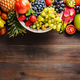 Ripe fruit and berries on a wooden background - PhotoDune Item for Sale