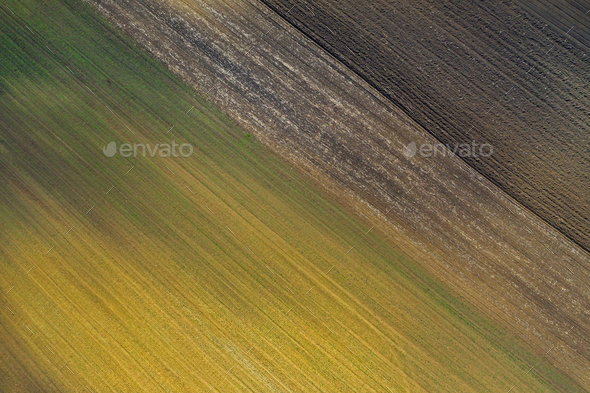 Aerial view of bio based industry and agriculture, plowed terrain in the spring from drone - Stock Photo - Images