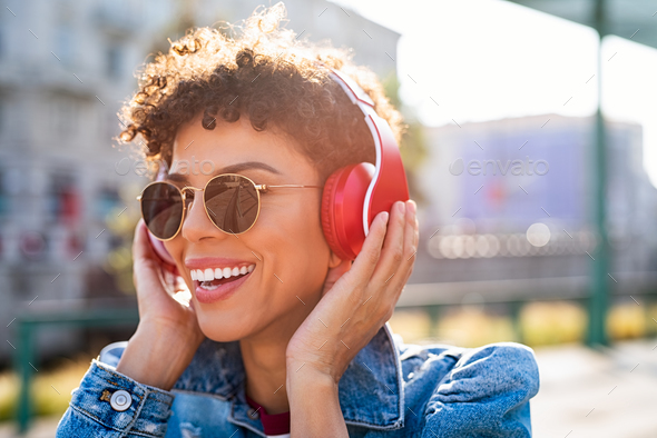 Happy african woman with headphones - Stock Photo - Images