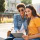 Two women using digital tablet outdoor - PhotoDune Item for Sale