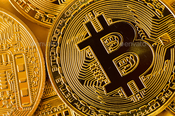 Top view closeup photo of gold bitcoins in a pile - Stock Photo - Images