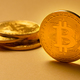 Gold bitcoin cryptocurrency coins on yellow backgound - PhotoDune Item for Sale