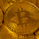 Top view closeup photo of many gold bitcoins - PhotoDune Item for Sale