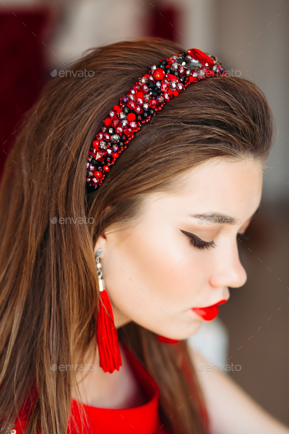 Above view of brunette girl wearing in shiny red hand band - Stock Photo - Images