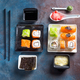 Traditional Japanese food- sushi, rolls, chopsticks, soy sauce on duotone slate background. Sushi - PhotoDune Item for Sale