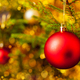 Decoration bauble on decorated Christmas tree background - PhotoDune Item for Sale