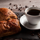 Mug of coffee with delicious pastry and spreaded beans of coffee - PhotoDune Item for Sale