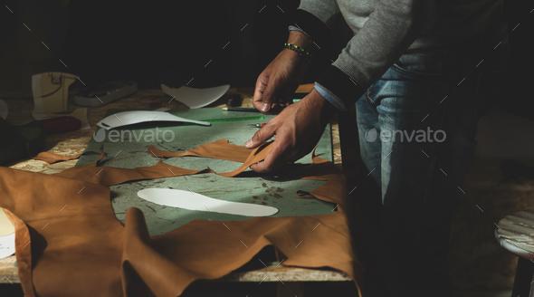 Shoemaker cutting leather - Stock Photo - Images