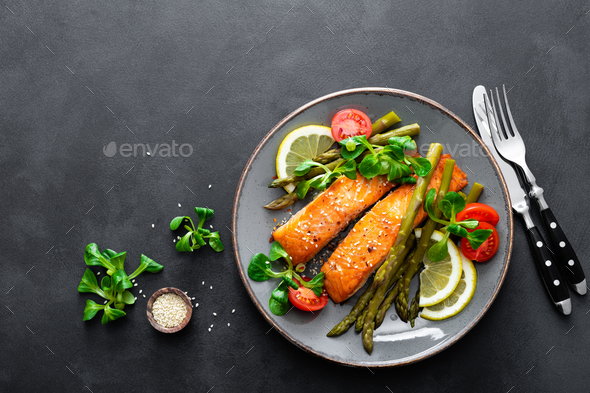 Grilled salmon fish steak, asparagus, tomato and corn salad - Stock Photo - Images