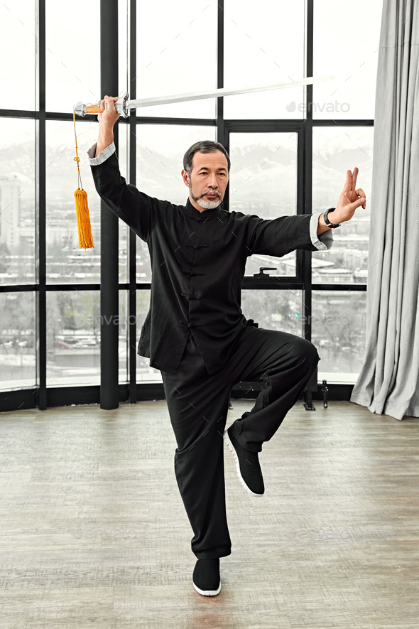 Couple of senior masters practicing qi qong taijiquan - Stock Photo - Images