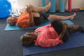 High angle view of determined senior couple exercising gym excercie in fitness studio - PhotoDune Item for Sale