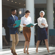 Front view of diverse business people walking with files in their hands in lobby - PhotoDune Item for Sale