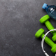 Fitness concept. Dumbbells, headphones and apple - PhotoDune Item for Sale
