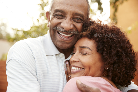 Senior black man and his middle aged daughter embracing, close up - Stock Photo - Images