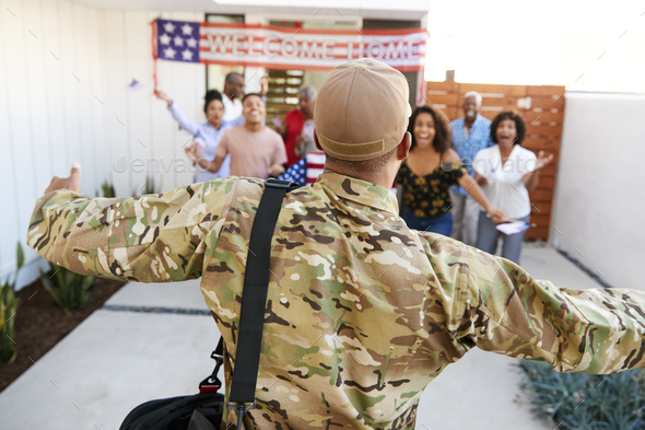Three generation black family welcoming millennial soldier returning home - Stock Photo - Images